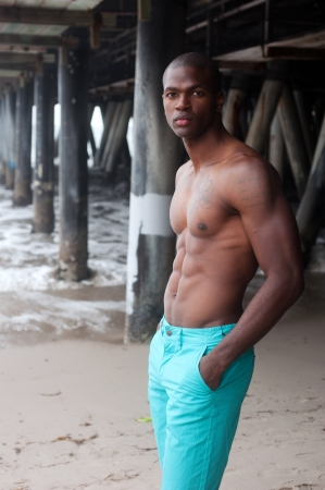 portrait of an African American male swimmer at the beach photo