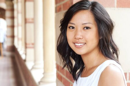 asian american: portrait of a pretty Asian college student on campus