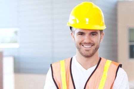 portrait of a happy construction worker shot outside photo