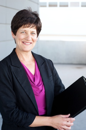 experienced: Portrait of a mature businesswoman taken outside Stock Photo
