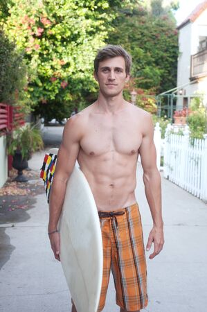 shirtless male: portrait of an active young man with a surfboard Stock Photo