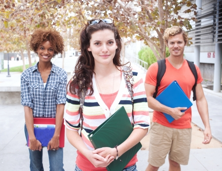 Happy group of students holding notebooks outdoors Stock Photo - 15413424