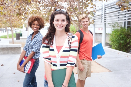 Happy group of students holding notebooks outdoors Stock Photo - 15413481