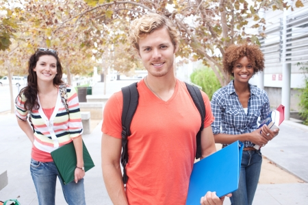 Happy group of students holding notebooks outdoors Stock Photo - 15413494