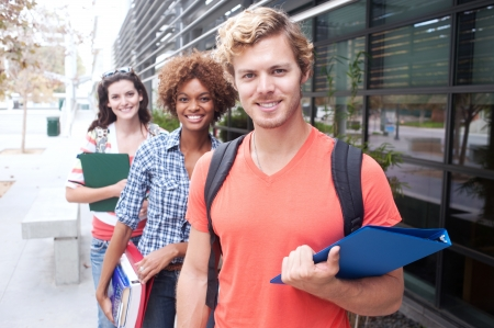Happy group of students holding notebooks outdoors Stock Photo - 15413499