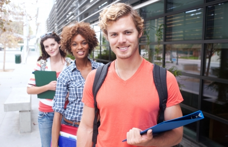 Happy group of students holding notebooks outdoors Stock Photo - 15413474