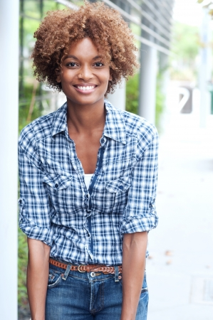 summer fun: pretty african american college student on campus