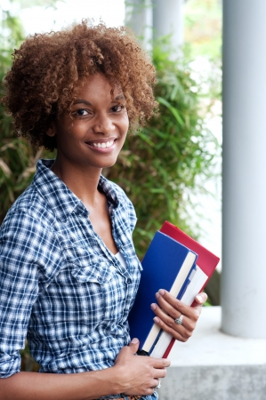 african tree: pretty african american college student on campus