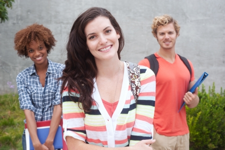 american content: Happy group of students holding notebooks outdoors Stock Photo