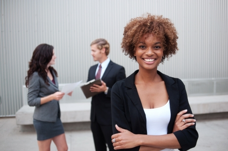 confident man: Portrait of an attractive young business group standing together at office