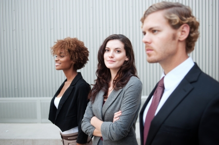 Portrait of an attractive young business group standing together at office photo