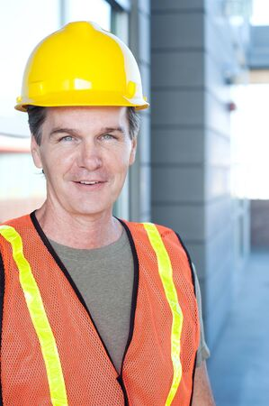 safety googles: portrait of a mature construction worker outside with hard hat