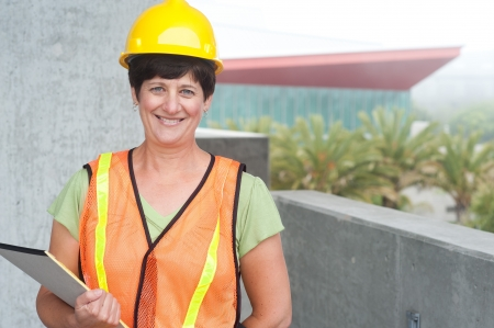 construction level: Woman construction worker in hard hat taken outside