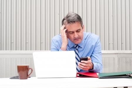 Businessman under stress, fatigue and headache at office Stock fotó