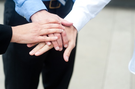 entrepreneurs: Business group with hands together - teamwork concepts