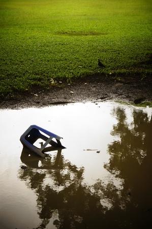 broken chair: Broken chairs in the water, park