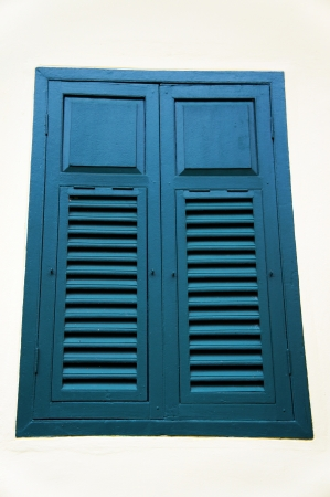The blue wooden window
