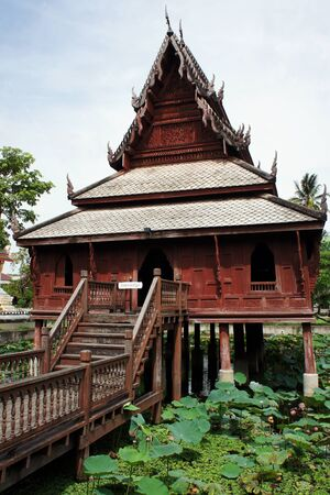 Ho Trai Klang Nam at Wat Thung Si Muang                   Editorial