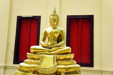Buddha statue and two window              photo