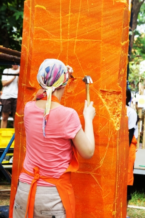 The Artist was carving candles in Ubon Candle Festival 2012