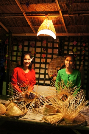 thani: 2 girls show their weaving bamboo in Loy Krathong Day Editorial