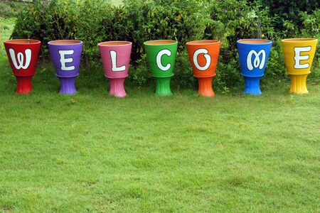 Welcome sign, at the flower pot photo