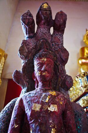 Small buddha statue in the church   Stock Photo - 21520395