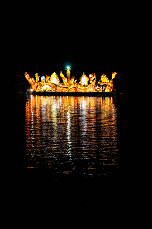 Illuminated boat festival in Isan, Thailand photo