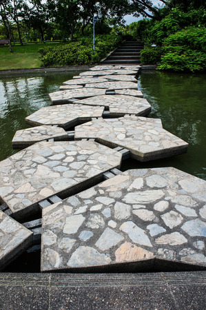 Decorative stones on a path across the pond 2 photo