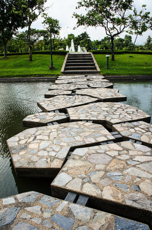 Decorative stones on a path across the pond photo