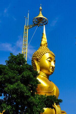 Golden Buddha statue under blue sky