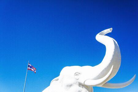 thai flag: Elephant statue and Thai flag