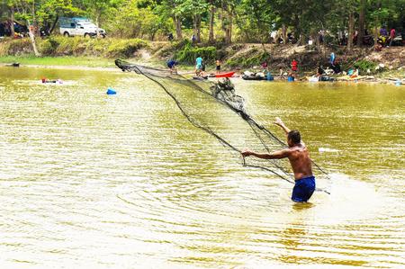 Fishermen use nets to catch fish Stock Photo