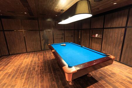 cue sticks: Pool table in game room