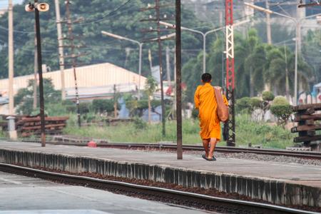 limosna: Buddhist monks alms round Station