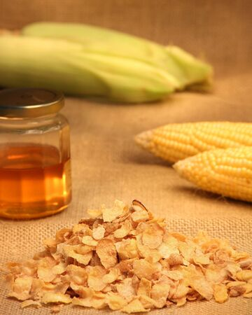 Conflakes cereal with honey and corn cobs Stock Photo