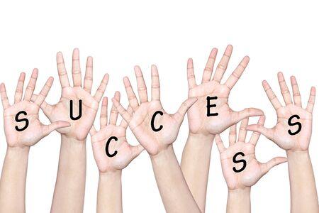 Verhoogde handen met succes van teamwork Stockfoto