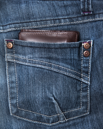 rivets: wallet in the back pocket of a demin pant