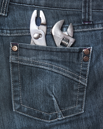 Person wearing a jeans with tools in his rear pocket photo