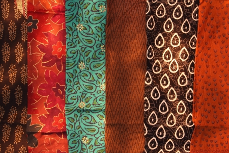 Traditional indian textiles arranged in a row
