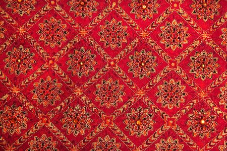indian fabric: Red colored textile used to make indian dresses