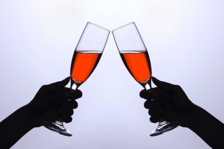 two hands with wine glasses - cheers Stock Photo