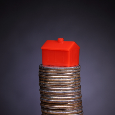 Mortgage - home icon on a stack of coins