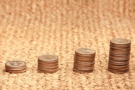 Growth - stacks of coins on a mat Stock Photo