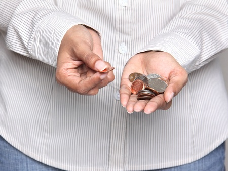 Savings - Business person holding coins photo
