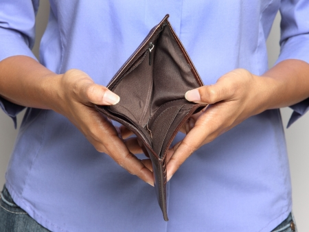 empty wallet: Bankruptcy - Business Person holding an empty wallet Stock Photo