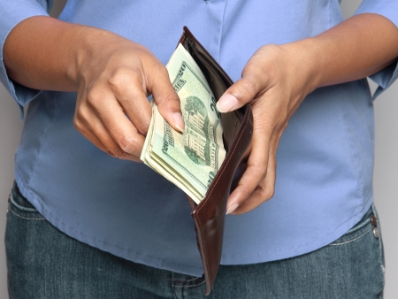 pay raise: business person holding wallet with money