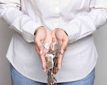 unsuccessful: Wealth - person holding US coins in her hands