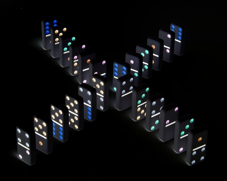 Dominoes formation on a black background Banco de Imagens