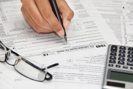 Person filling 1040 federal tax form
